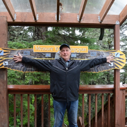 Jim is 6 feet and the eagle wingspan is bigger than his